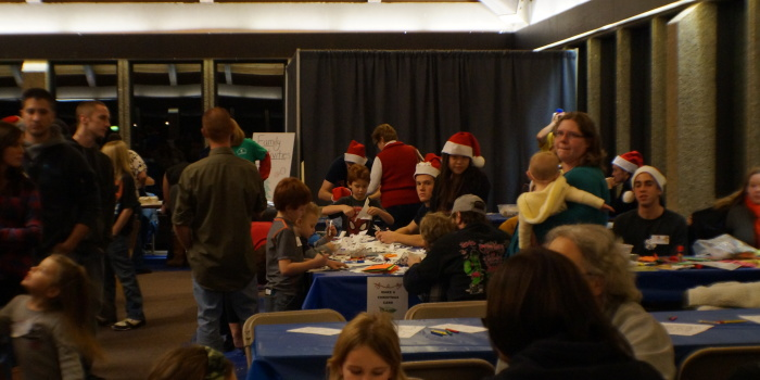 Holiday party honors past student, serves community