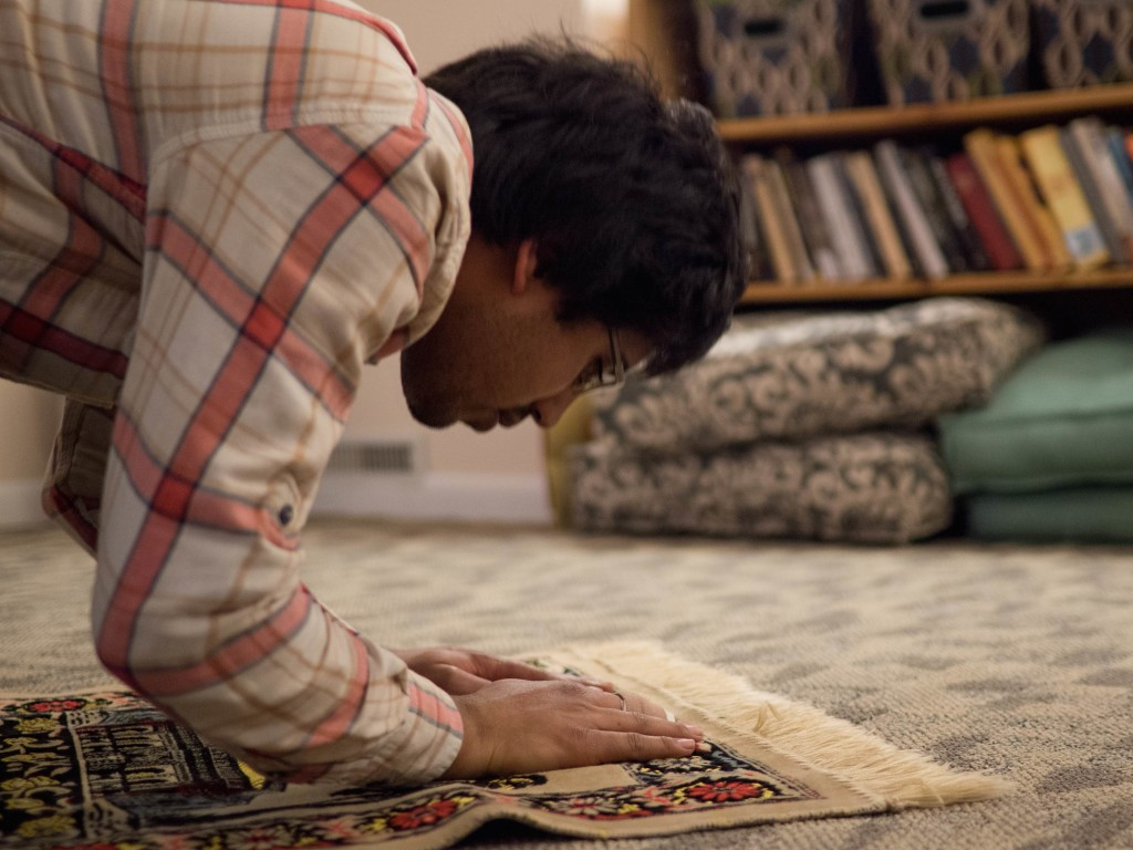 Muhammed Hansrod '17 prays at the Center.