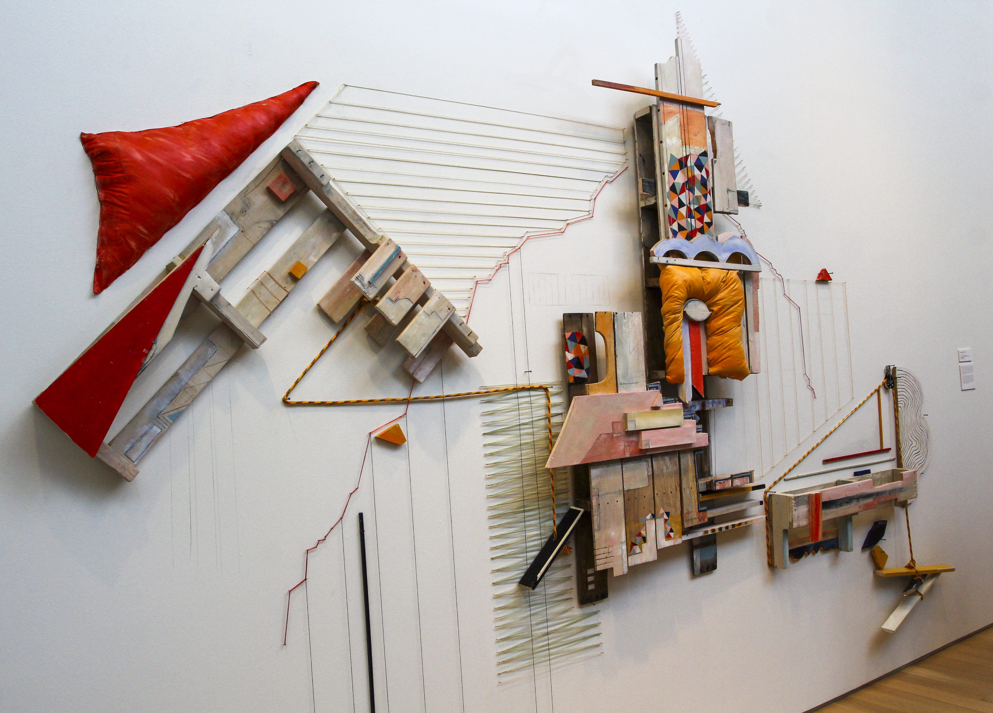 """Constructed from various wooden structures and covered in bright, saturated oranges, yellows and blues, De Pascuale's sculpture commands the viewer's attention. Inspired by the playfulness of Spanish architecture, De Pascuale used color and form to invite the audience into the feeling tof the style. """"They make these huge, beautiful pink and blue spaces that are supposed to match the landscape,"""" she said. """"I like the idea of making something that you look at that makes you feel like you're in that kind of space."""""""
