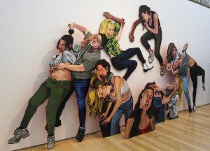 "nspired by the VH1 show Bad Girls Club, Chloe Friedman's The Trouble with Boys Series is off the wall, literally. Composed of various wooden, larger-than-life cut-out portraits of her friends in fighting positions, the piece reflects the artificiality of fighting for the entertainment of others. To further achieve a sense of artificiality, Friedman painted exaggerated versions of posed photographs. ""It kind of has a naìve style and goes well with the fact that it is meant to be artificial,"" Friedman said. The final product gives a sense of exaggerated reality and whimsy to the violence depicted."