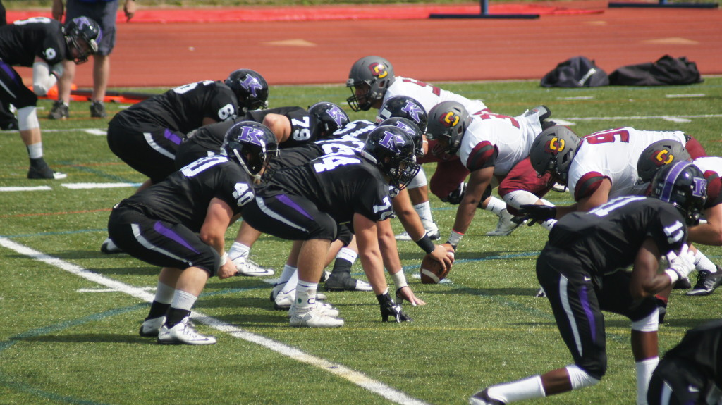 Kenyon's offense lines up against the Oberlin defensive line. | Catherine Smith '20
