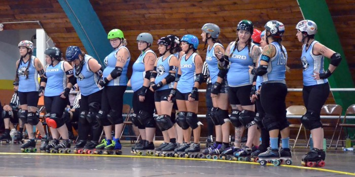 On the rink, Kenyon employee skaters get down and derby