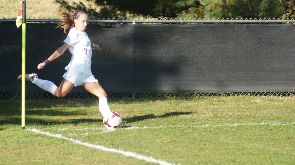 Gillian Blackwell '18 launched a corner kick at Mavec Field in yesterday's 3-1 defeat of Hiram College. The victory moved the Ladies' NCAC record to 3-0-1. | Cat Smith