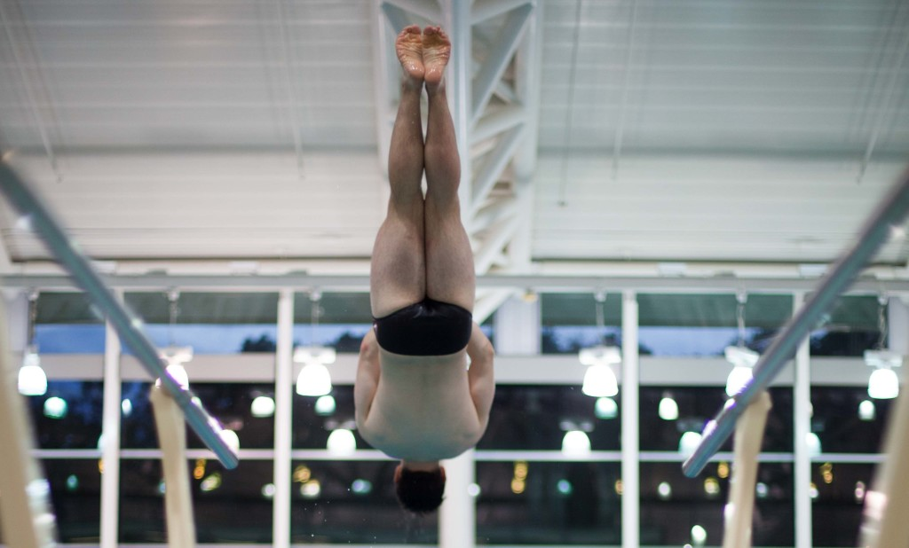 Ryder Sammons '19 takes a practice dive into the James A. Steen Aquatic Center pool. Sammons is one of seven on Kenyon's diving team this season. | Jack Zellweger