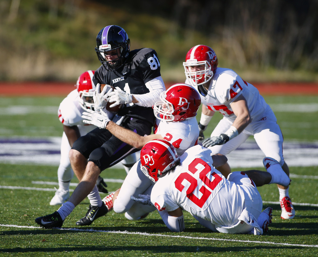No. 81 Ian Robertson '19 fights through the grasp of four Denison defenders Saturday. | Shane Canfield