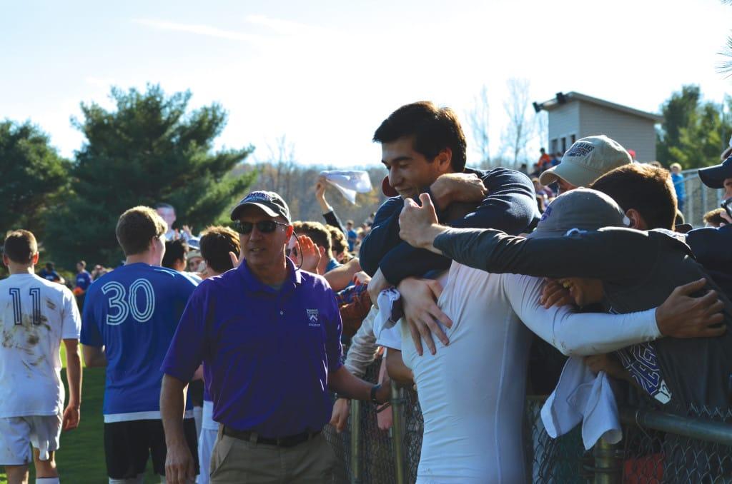 The Kenyon crowd embraces Stengel, in white, at Mavec Field. | Jess Kusher