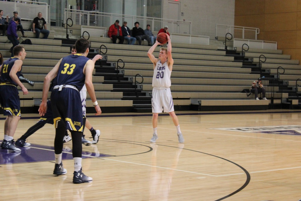 Carter Powell '20 shoots a three-pointer against Allegheny in yesterday's home game. | Daisy Collins